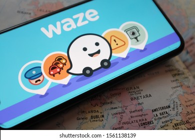 Smart phone with the WAZE logo. Waze is a real-time automotive traffic social application. United States, New York Friday, October 15, 2019