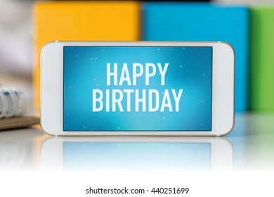 Smart phone which displaying Happy Birthday
