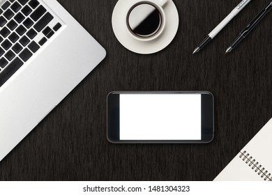 Smart phone with white blank screen and laptop, coffee, book on work desk top view