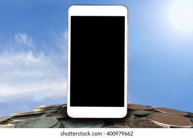 smart phone,tablet,cellphone on stack coins over  blurred of blue sky on day noon light background,abstract background for mobile banking,online banking concept.