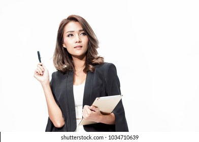 Smart professional asia business woman in black suit and white dress holding pen and tablet thinking new project on white background,business woman concept idea.