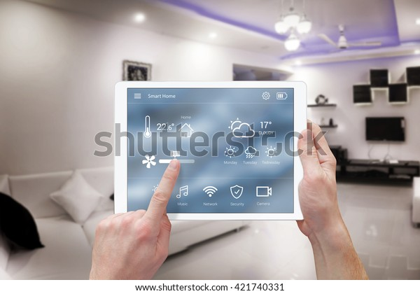 Smart remote home control system app. Living room interior in background.