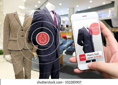 smart retail marketing concept. Hand holding smart phone and application to check number of social media like and sale price in retail fashion shop