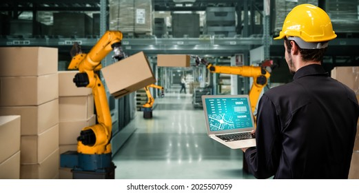 Smart robot arm systems for innovative warehouse and factory digital technology . Automation manufacturing robot controlled by industry engineering using IOT software connected to internet network .