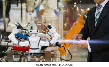 smart robot replacement Industrial 4.0 of things technology robot future arm and man using controller for control electronic