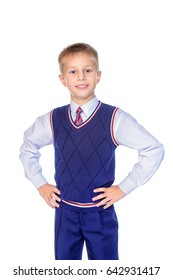 Smart school boy smiling at camera. Educational concept. Isolated over white background.