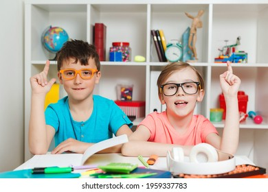 Smart school kids learning together at class. Education concept. Happy students at workplace. Thoughtful boys sitting at the table. Back to school concept. Boys at lesson in classroom.