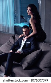 Smart, serious couple in a luxurious hotel's apartment