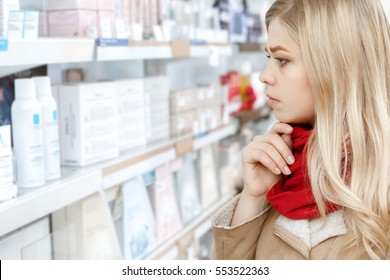 Smart shopping. Close up cropped profile shot of a beautiful young woman choosing products thoughtfully at the local store copyspace store shop shopper choice choosing shopping consumerism concept
