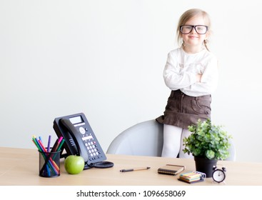 Smart, smilling girl working at the office. Success, Idea. Communication in business concept.