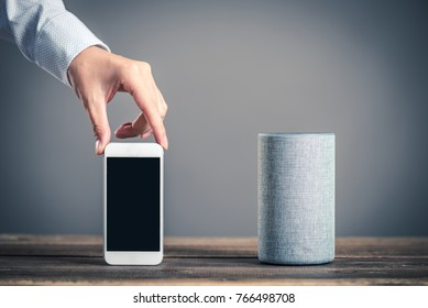 Smart speaker and male hand