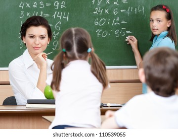 Smart teacher questions pupils at mathematics