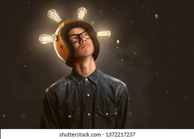 Smart teenager wears a lightbulb helmet