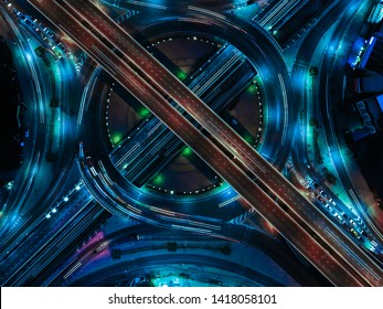Smart transportation with Expressway, Road and Roundabout, busy highway traffic night time. Important infrastructure.