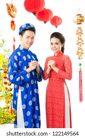 Smart Vietnamese couple in traditional clothes celebrating New Year