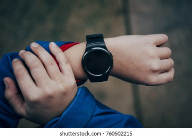 Smart watch on the boy's hand-from above