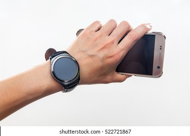 smart watch on hands with smart phone, on white backgrounds