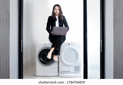 smart woman action on waching matchine in cleaning room at home