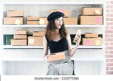 Smart woman, Asian small business owner at home office, on line marketing packaging boxes and delivery, SME concept. Young Owner People Start up for Business Online, SME, Delivery Project.