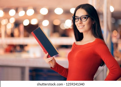 Smart Woman Holding a Book in a Store. Intellectual girl reading a novel in a library