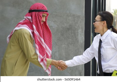 Muslim women stock photos images photography shutterstock smart woman is shaking hand with arabian business man she is greeting him with big m4hsunfo