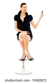 smart woman sitting on a stool holding a cellphone on white background