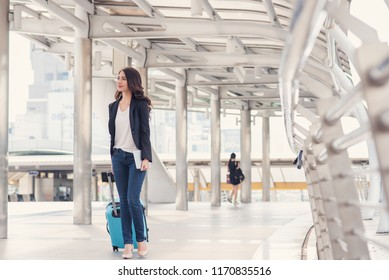 Smart women are traveling with luggage.