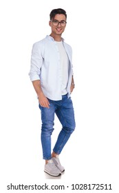 smart young casual man standing with hand in pocket on white background