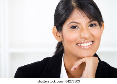 smart young latin businesswoman closeup portrait