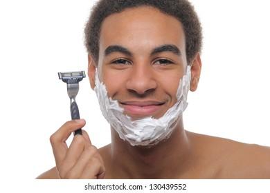 Smart young man shaving