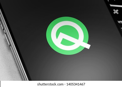 smartphone with Android Q logo on the screen. Google Android is the operating system for smartphones, tablet computers, e-books, game consoles, and other devices. Moscow, Russia - May 20, 2019