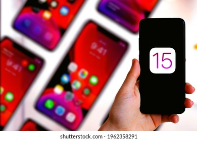 Smartphone with the apple logo iOS 15 is a mobile operating system from the multinational Apple Inc. Originally developed for the iPhone. United States, California April 5, 2021