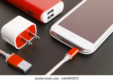 smartphone battery and usb charging cable with copy space