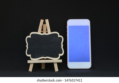 Smartphone and Black Board on Easel Front View. online Sale