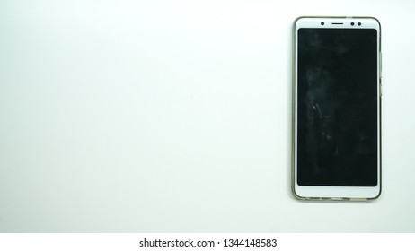 Smartphone with a black screen and an elegant white background