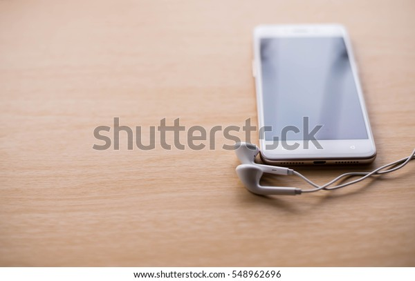 Smartphone with black screen On Wooden Table With Copyspace
