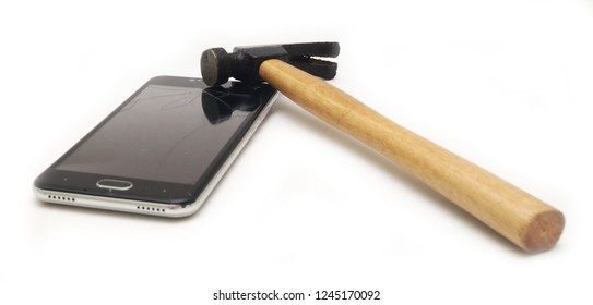 Smartphone with broken screen with a hammer