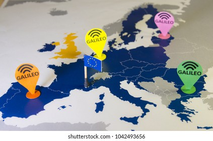 Smartphone and car over a EU map.Symbolizing the Open European Galileo Global Satellite Navigation System.In April 2018,all new vehicles sold in Europe will be ready for this system.