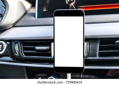 Smartphone in a car use for Navigate or GPS. Car with Smartphone in holder. Mobile phone with isolated white screen. Blank empty screen. copy space. Empty space for text. modern car interior details.