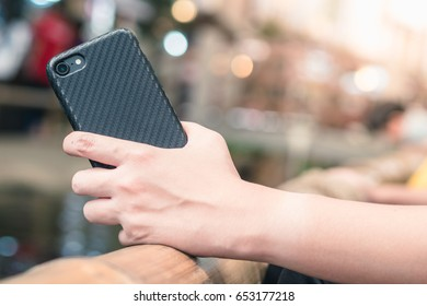Smartphone case :  held by a woman's hand