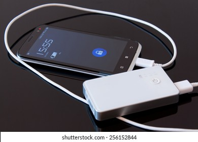 Smartphone is charging with power bank while it standby
