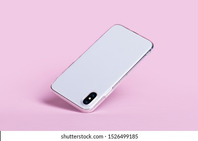 Smartphone in clear iPhone X silicone case falls down, back view. Phone case mockup