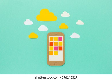 Smartphone with colorful app symbols in cloud network