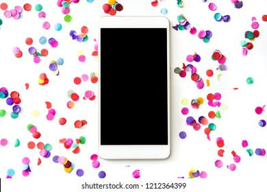 Smartphone with confetti isolated on white background. Mockup