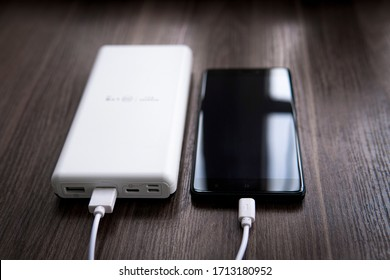 smartphone connected to the power bank