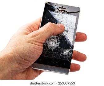 Smartphone with cracked display in hand