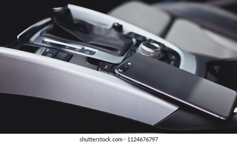 smartphone with dual camera in the interior of a modern car