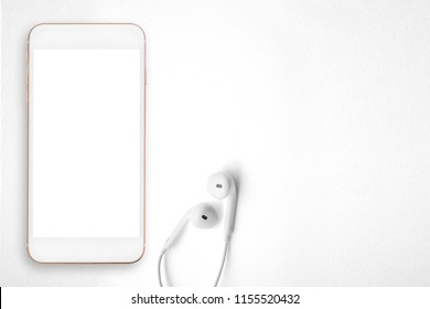 Smartphone and earphones on white background.