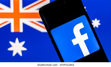 Smartphone with Facebook logo against the flag of Australia in the background. Facebook recently banned users in Australia from sharing or Viewing News on the platform.