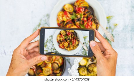 Smartphone food phone. Phone photography of ratatouille - French vegetable stew dish. For blogging or social media. Vegan or vegetarian lunch.